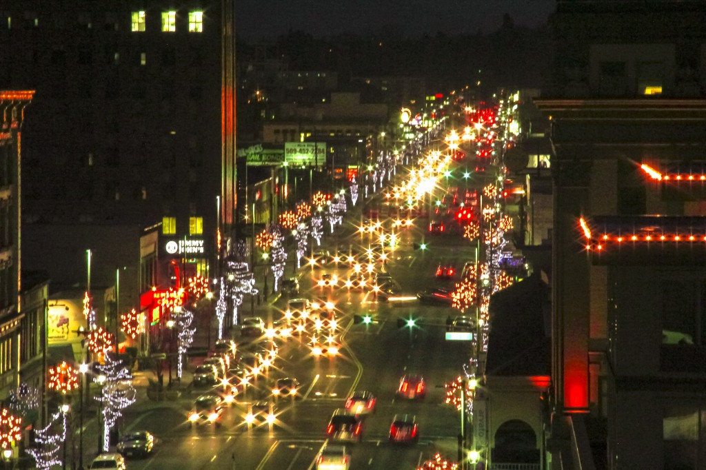 Traffic lights add extra twinkle as decorative lights frame Yakima Avenue during the Holiday season.