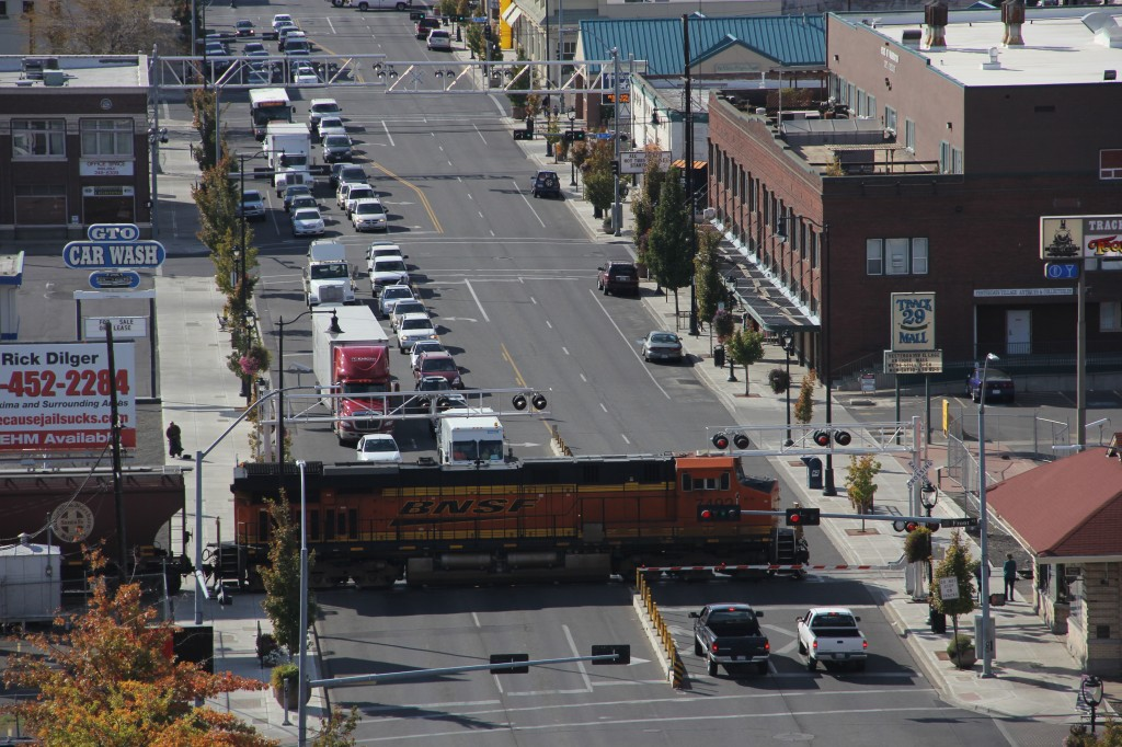 Cars wait at the cross arms on Yakima Avenue as a Burlington Northern rolls by.