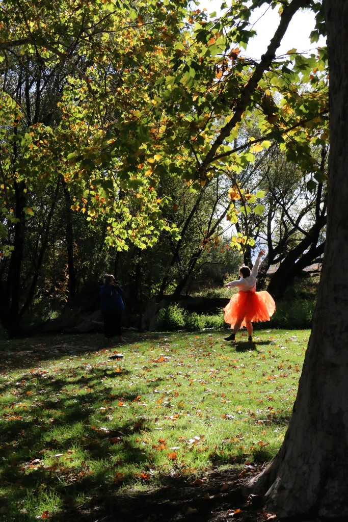 A photographer and her model take the opportunity for a photo shoot during a spectacular fall day in a Yakima Park.