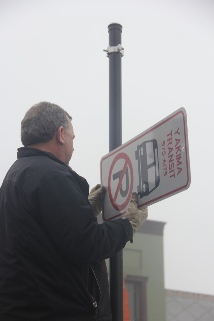 Transit Driver Dave Edwards removes Yakima Transit Route signs along Yakima Avenue which was part of the recently eliminated Yakima Transit Route 8.
