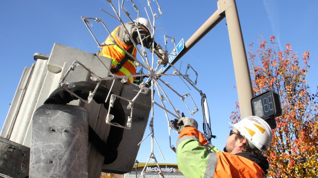 City of Yakima crews hang lights and decorations in downtown Yakima that signify the start of the  holiday season.