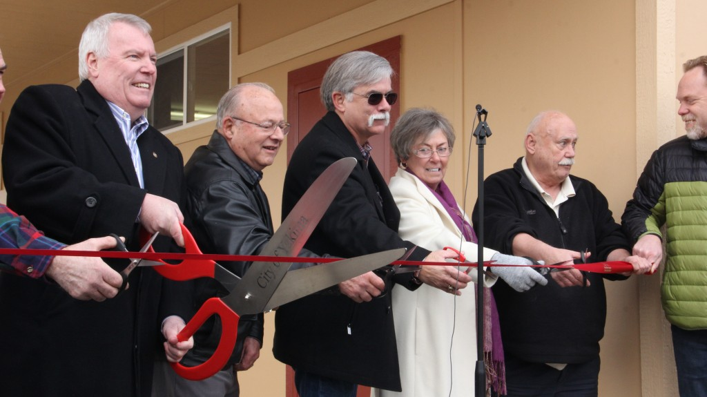 Dignitaries cut the ribbon to open the new Rotary Food Bank on.