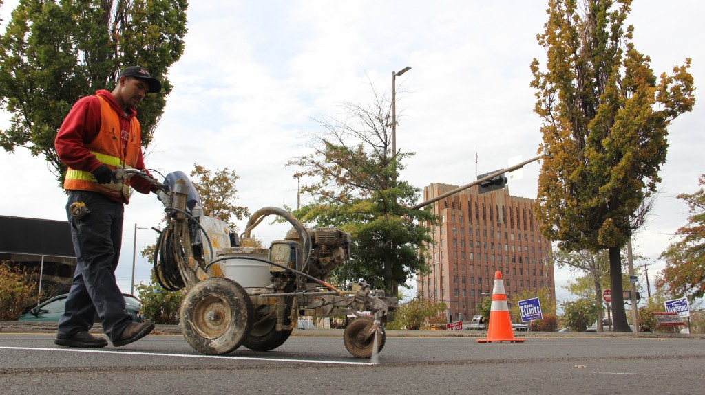 Gabriel Chavez of Stripe Rite Inc. lays down a new line as parking changes come to Downtown Yakima.