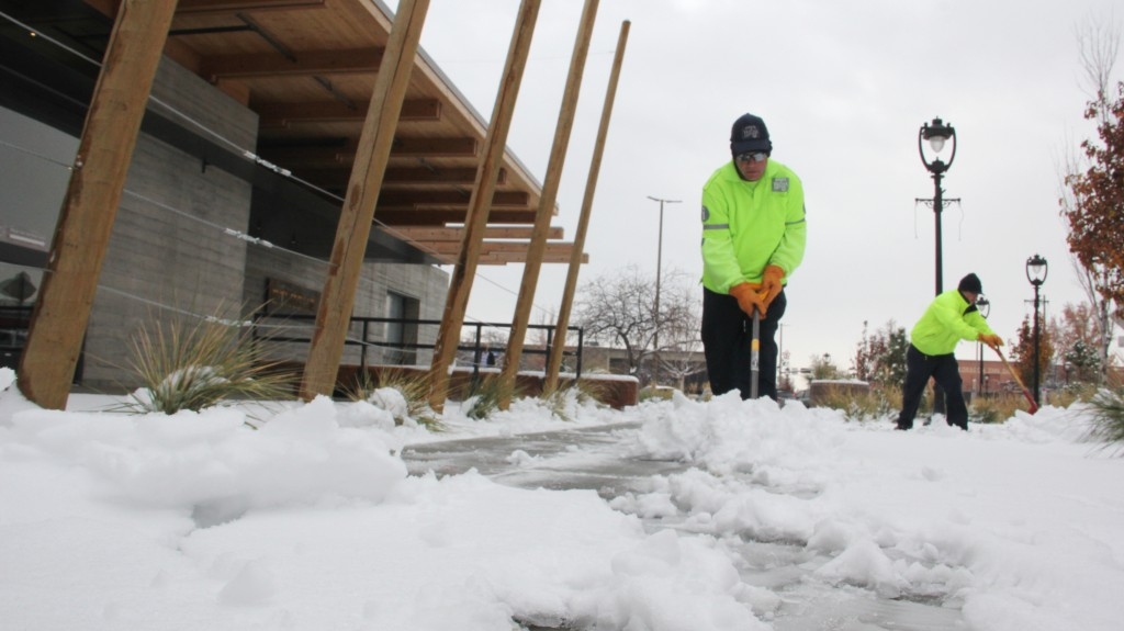 Downtown crews shovel the sidewalks on 2nd Street after an early season snowfall in Yakima.