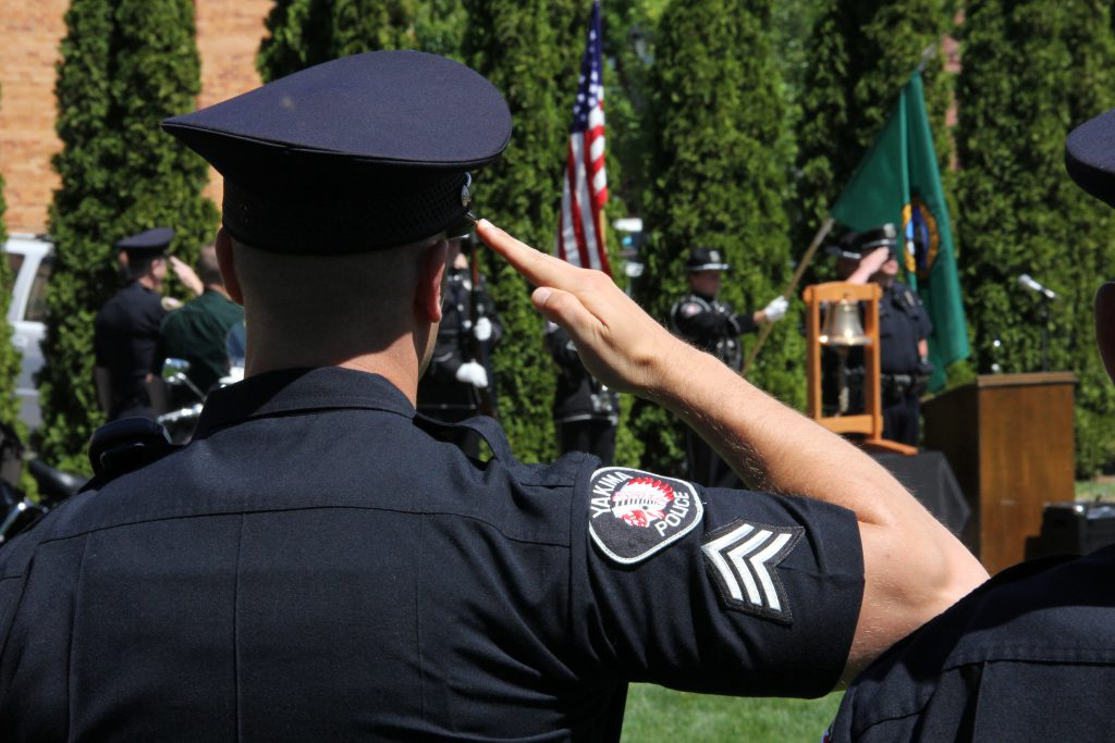 A Yakima Police sergeant salutes during the  presentation of colors at a memorial honoring the 124 Peace Officers killed in the line of duty over the last year.