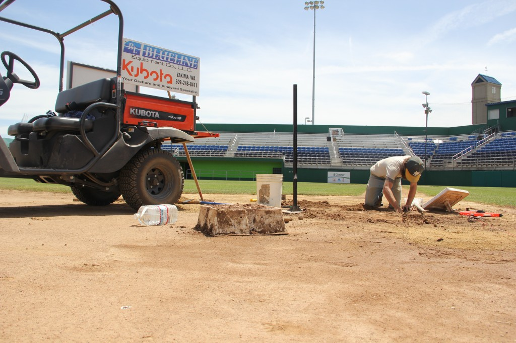 Yakima Valley Pippins Head Groundskeeper Shawn ___ works on third base prepping Yakima County Stadium for the return of baseball with a new look on June 6th when the Yakima Valley Pippins begin their season.