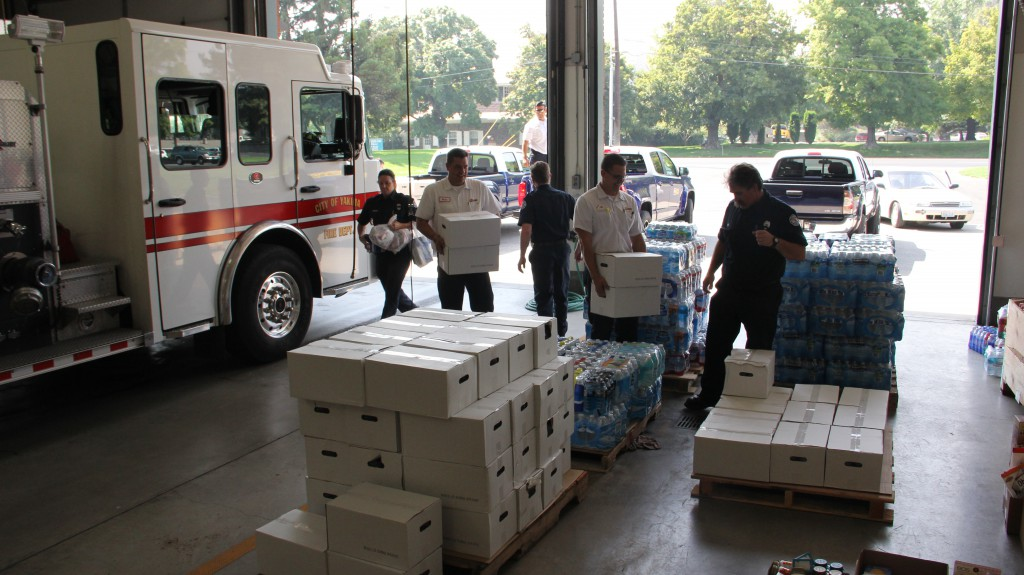 Community members and businesses stopped with donated supplies that quickly filled an engine bay at Yakima Fire Station 93. The supplies will be sent to the Okanogan Complex Fire Supply Drive.