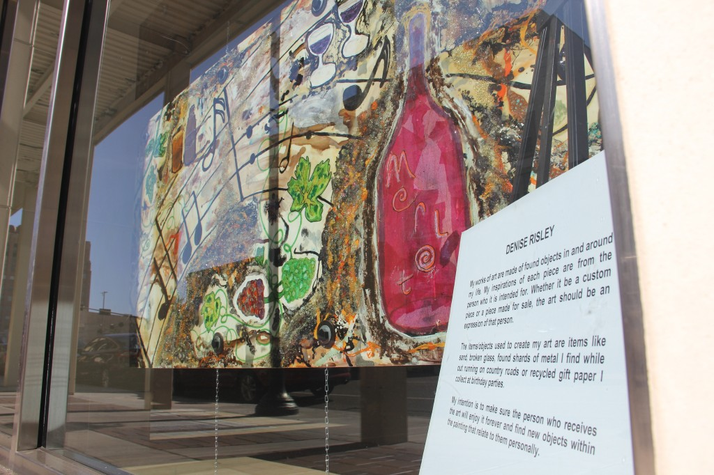 Denise Risley's painting, as part of her Windows Alive! display, fills an empty store window in Downtown.