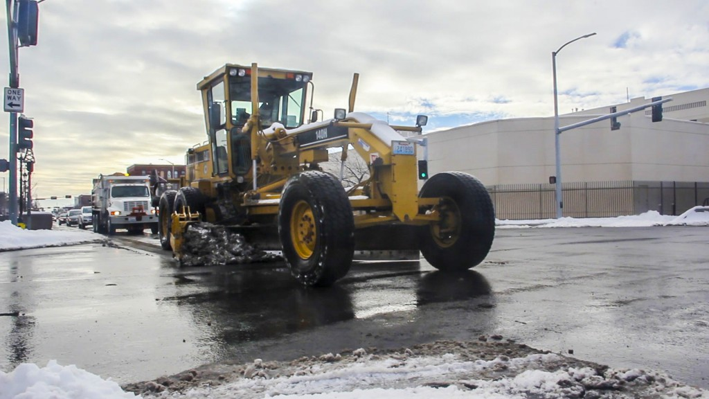 A City of Yakima crew clears North 1st Street after more snow covers Yakima streets during the holiday weekend.