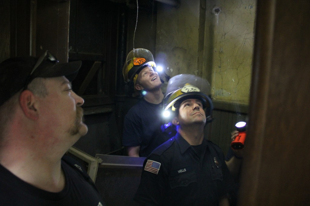 West Valley Fire Fighters look into a ceiling panel following a joint training session with the Yakima Fire Department at Yakima's Wilson Building.